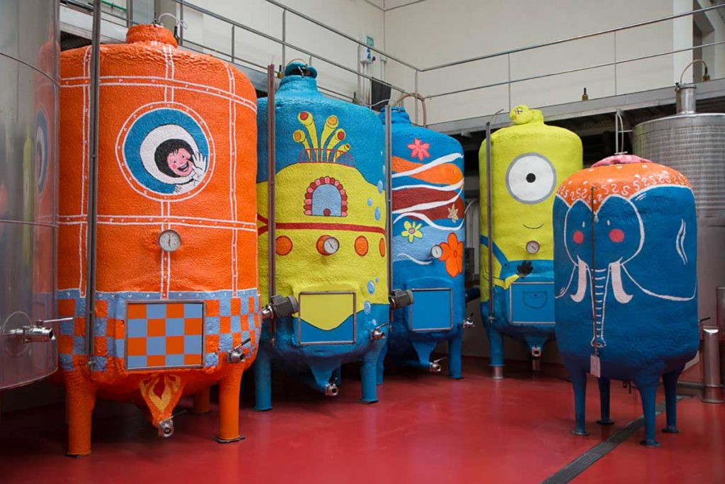 Colourfully-painted-steel-tanks-on-a-Majorcan-winery